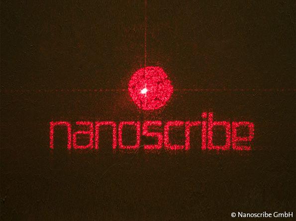 Nanosribe logo projected through a DOE with a laser. Photo via Nanoscribe GmbH