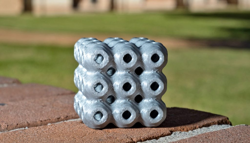 A Rice 3D printed schwarzite brick. Photo via Rice University
