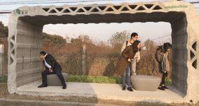 Students inspect the new bus shelter. Photo via WinSun.