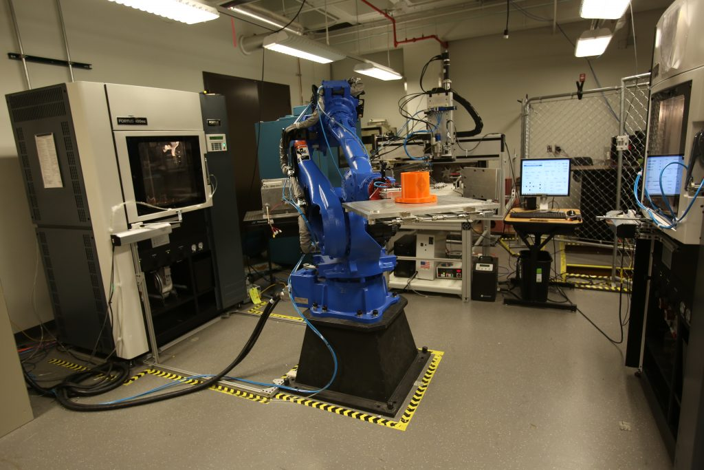 The Keck Centre's Multi3D system switches parts for 3D printing between twin Fortus systems. Photo via UTEP/Keck
