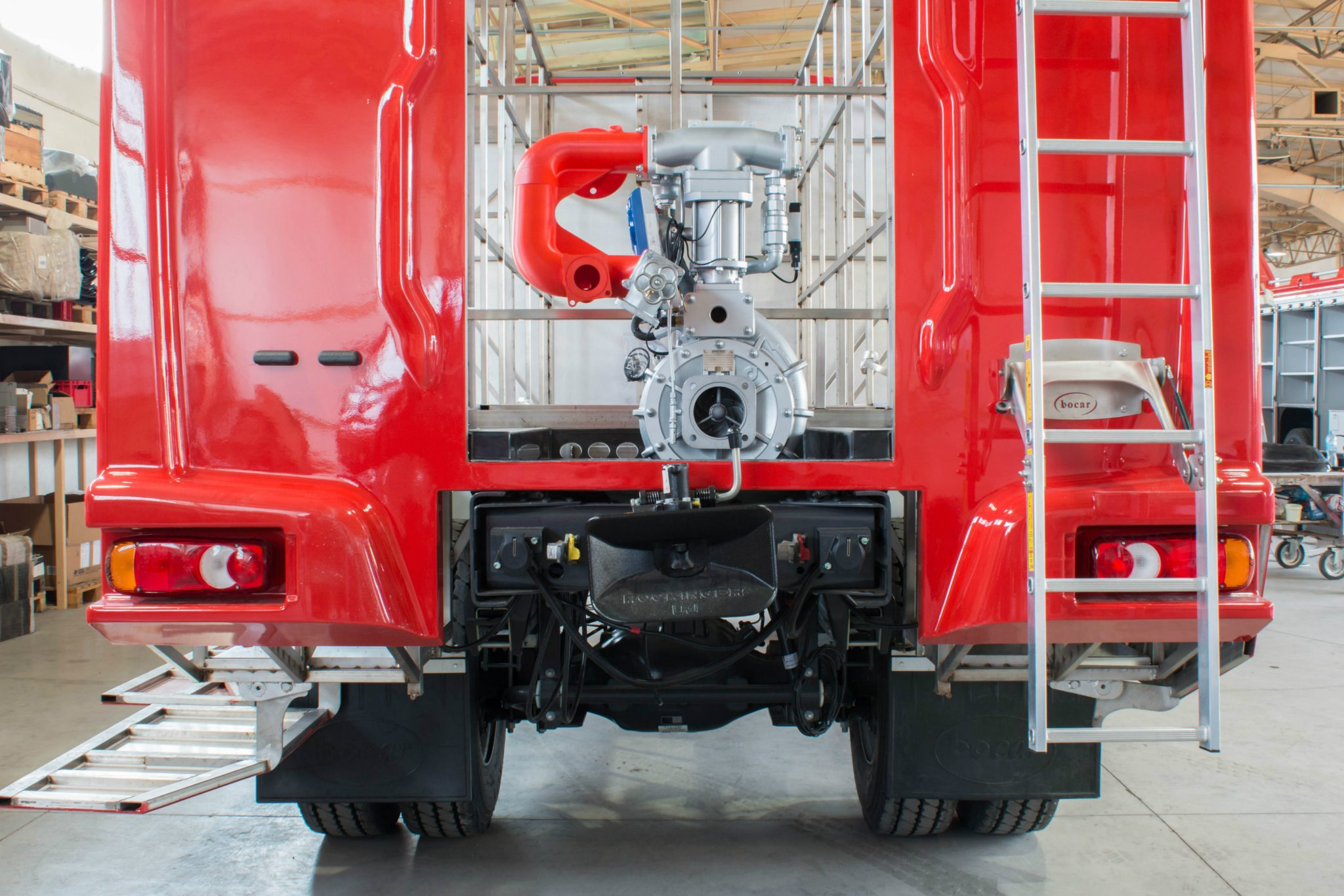 The red 3D printed vacuum manifold installed on a Bocar fire truck. Photo via 3DGence