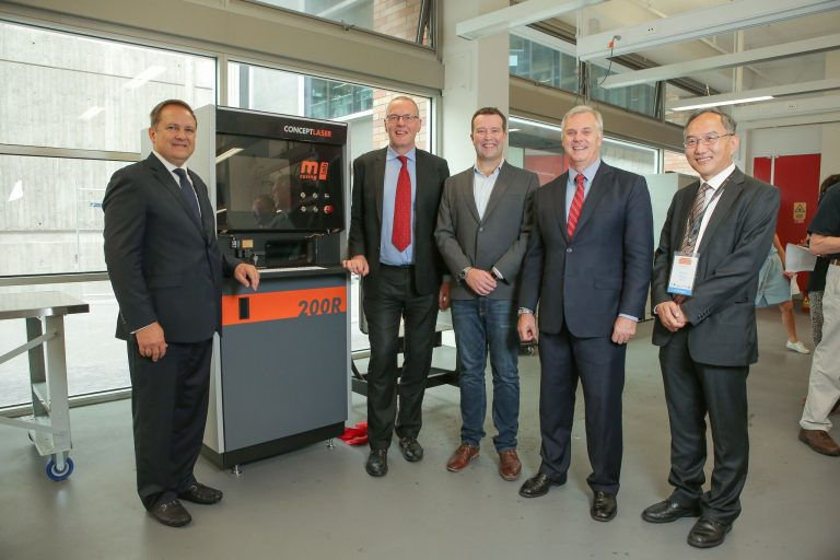 GE Australia CEO Max York (L) with Univeristy of New South Wales staff after receiving a concept laser as part of the AEP. Photo via Maja Baska/GE.