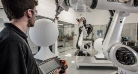 A KUKA robotic arm in operation at Birmingham's Advanced Manufacturing Facility. Photo via Autodesk/AMF