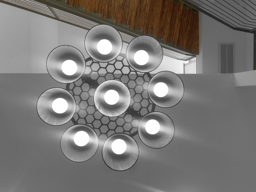 Photo from beneath Andrew McCalip's 3D printed Falcon 9 chandelier. Photo via Andrew McCalip