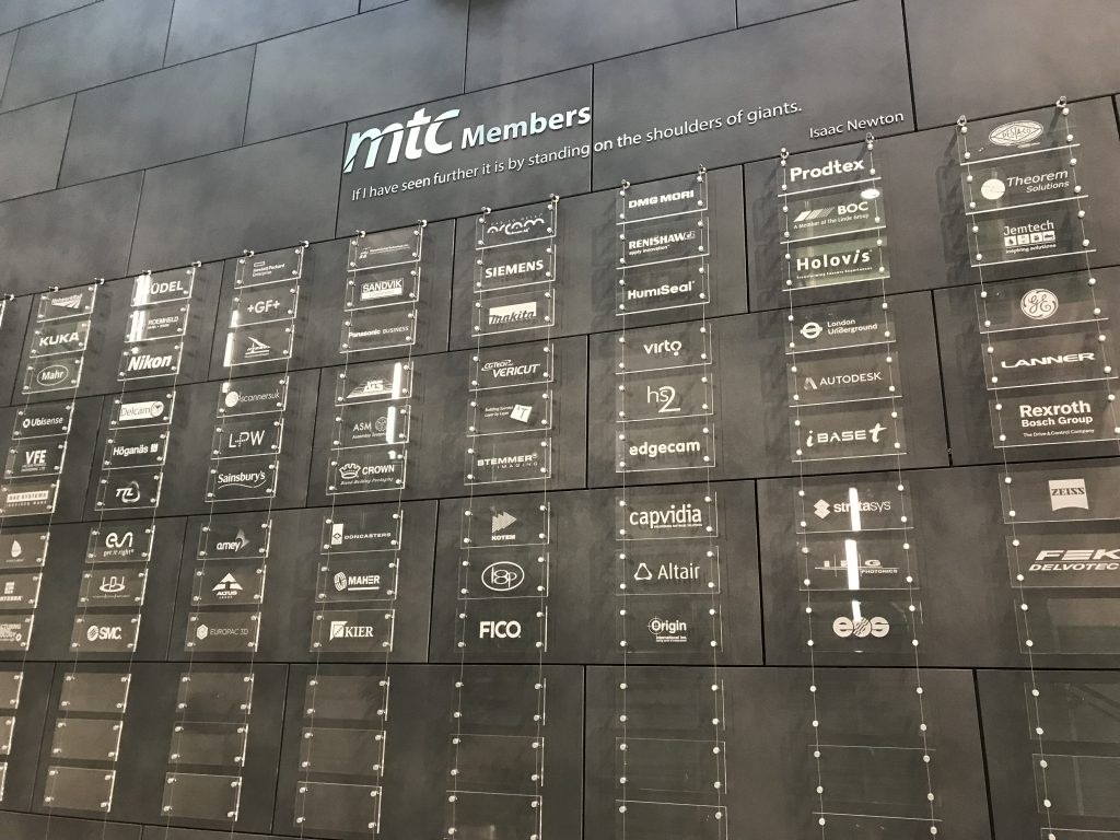Wall of members at Coventry's MTC, including Rolls-Royce, Airbus, EOS and Autodesk. Photo by Beau Jackson
