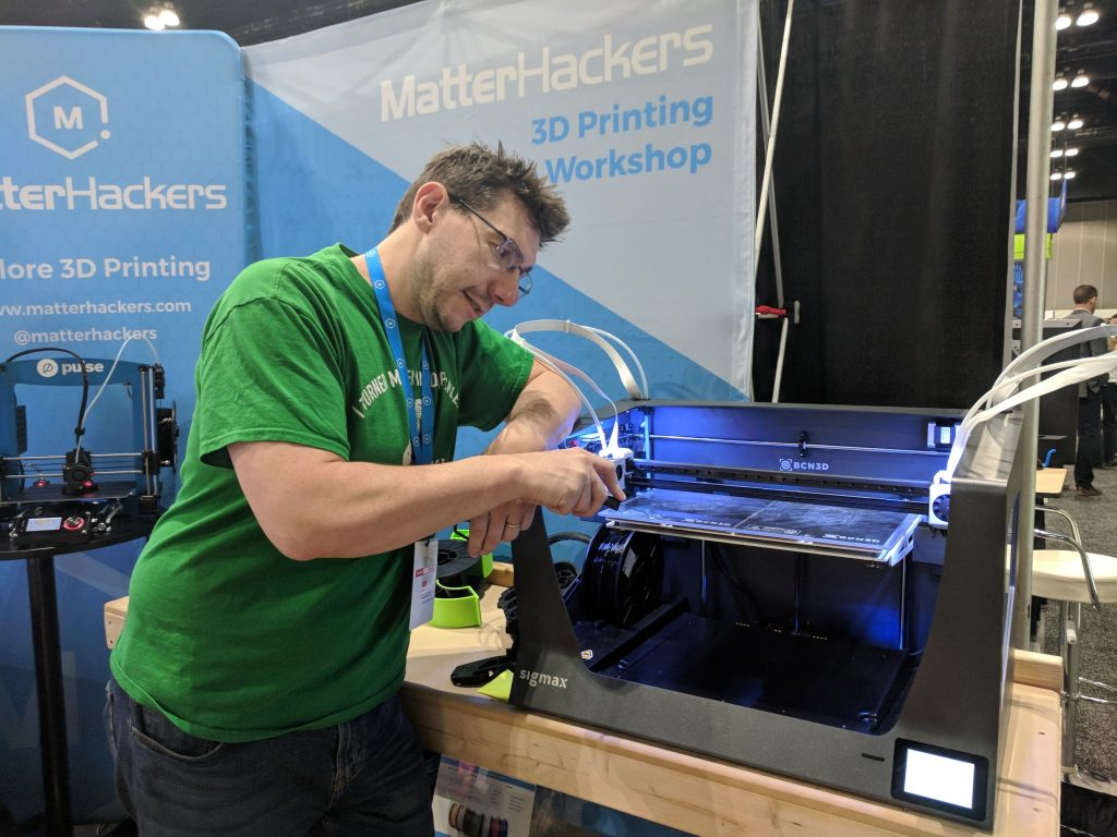 Joel Telling removes a 3D print from the BCN Sigmax. Photo by Michael Petch.