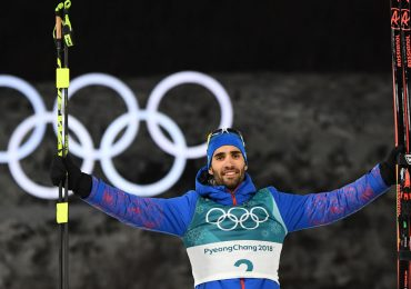 Martin Fourcade winning his final ski pursuit. Photo via Guardian Nigeria/Getty Images.