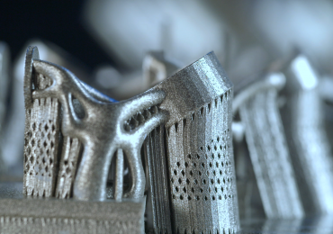 Metal components, 3D printed in a Sintavia machine on a build plate. Photo via Sintavia.