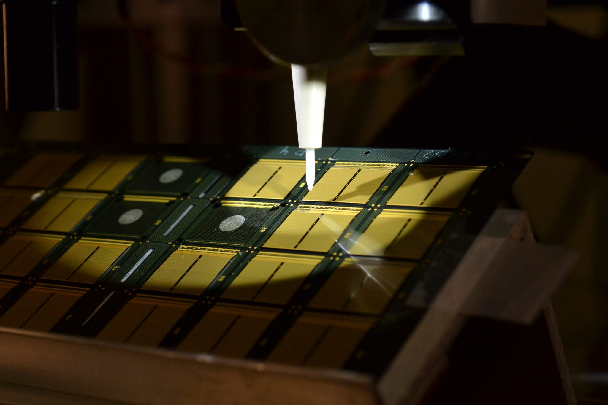 Optomec stacked die electronics 3D printing certification. Photo via Optomec