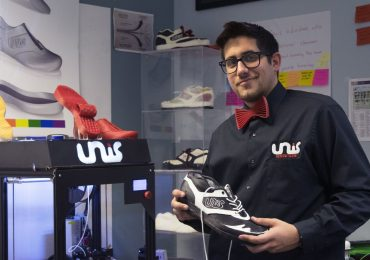 Unis displays his 3D printed running shoes at the Launchbox. Photo via Samantha Wilson/The Collegian