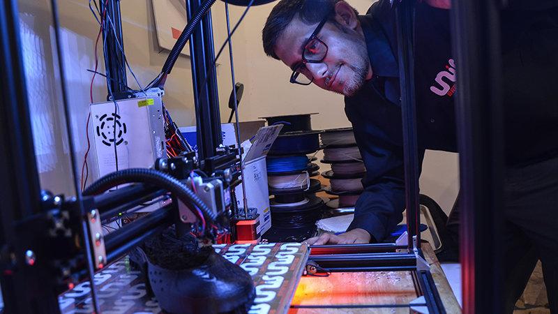 Unis custom built 3D printer. Photo via Penn State.