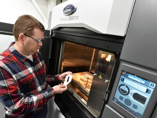 Tooler Wayne McKinney 3D prints a specialist tool at the Ford Louisville plant. Photo via Ford.