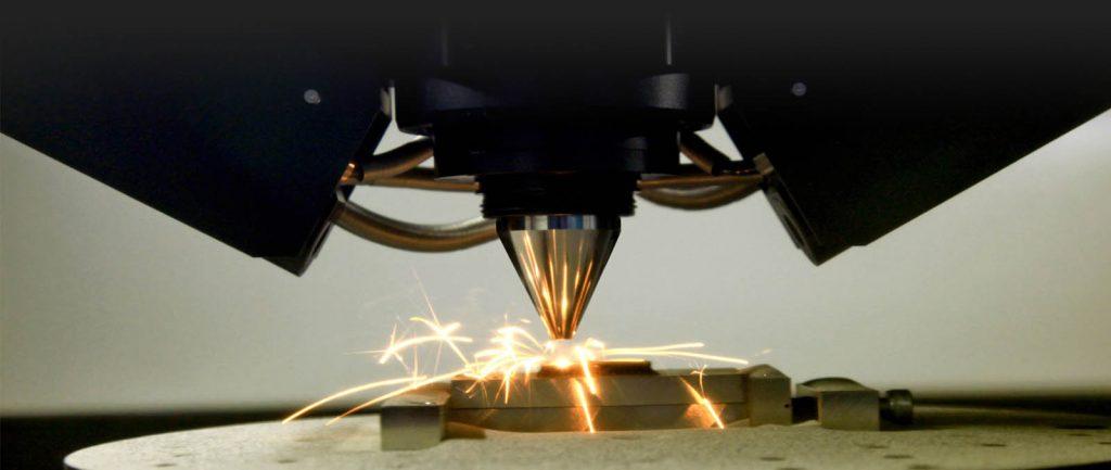 EBM 3D printing in action at CalRAM's Cupertino, California Facility. Photo via CalRAM.