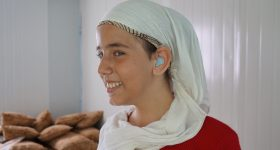A girl in Jordan provided with hearing aids from HLID.