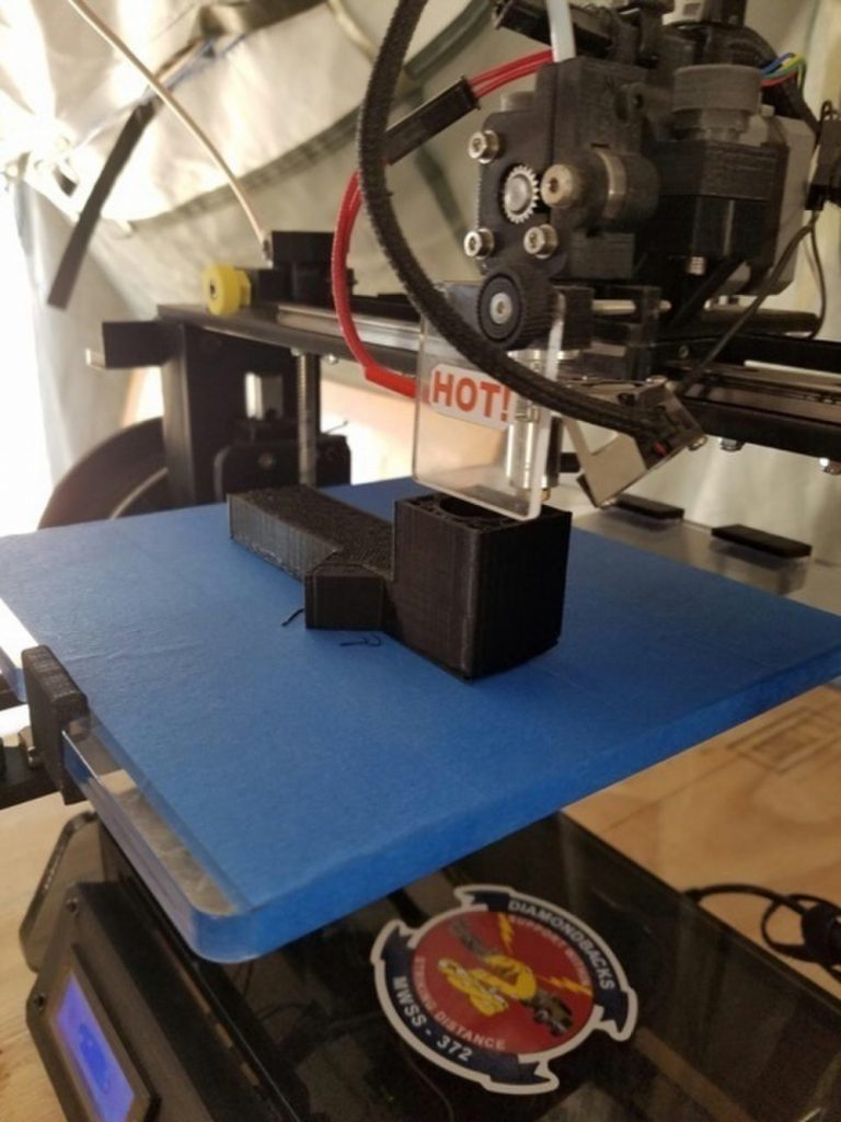 3D printing a spare part at Marine Wing Support Squadron 372. Photo by Sgt. Brytani Wheeler