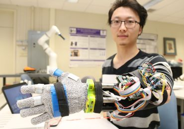 3D printed tremor suppression glove worn by Yue Zhou, a doctoral student at Western University. Photo via Western University.