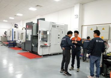 Team inside one of 3ERP factories. Photo via 3ERP