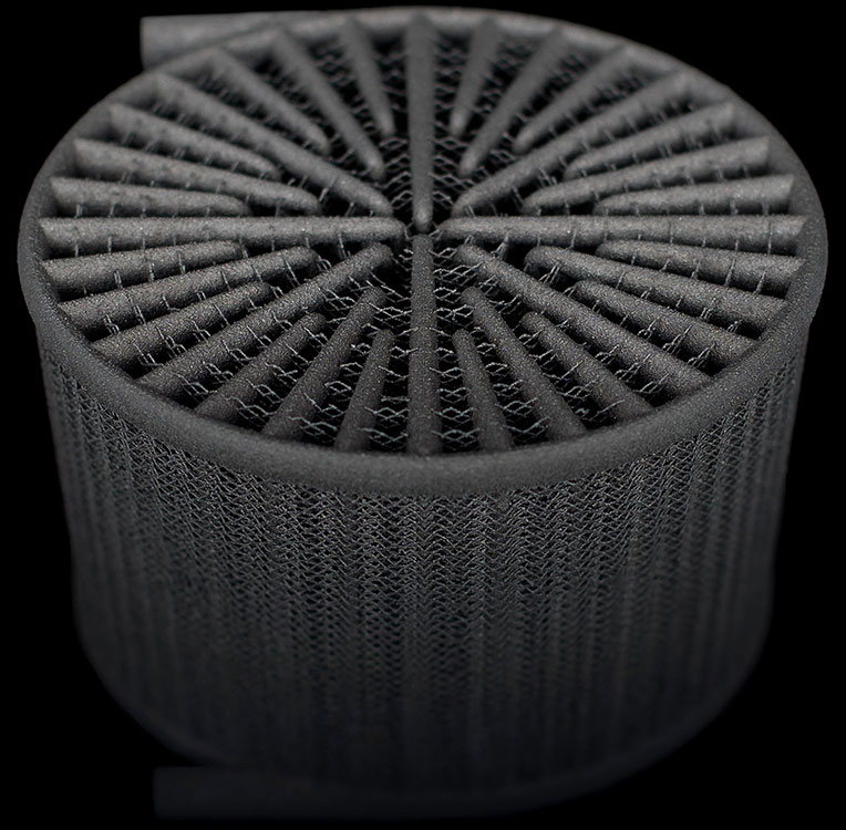 Redesigned heat exchanger 3D printed in an aluminum alloy on an EOS M280. Image via Betatype