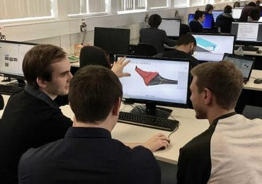 Ed Barlow, left, designing the UAV in Autodesk Fusion 360. Photo via University of Warwick.