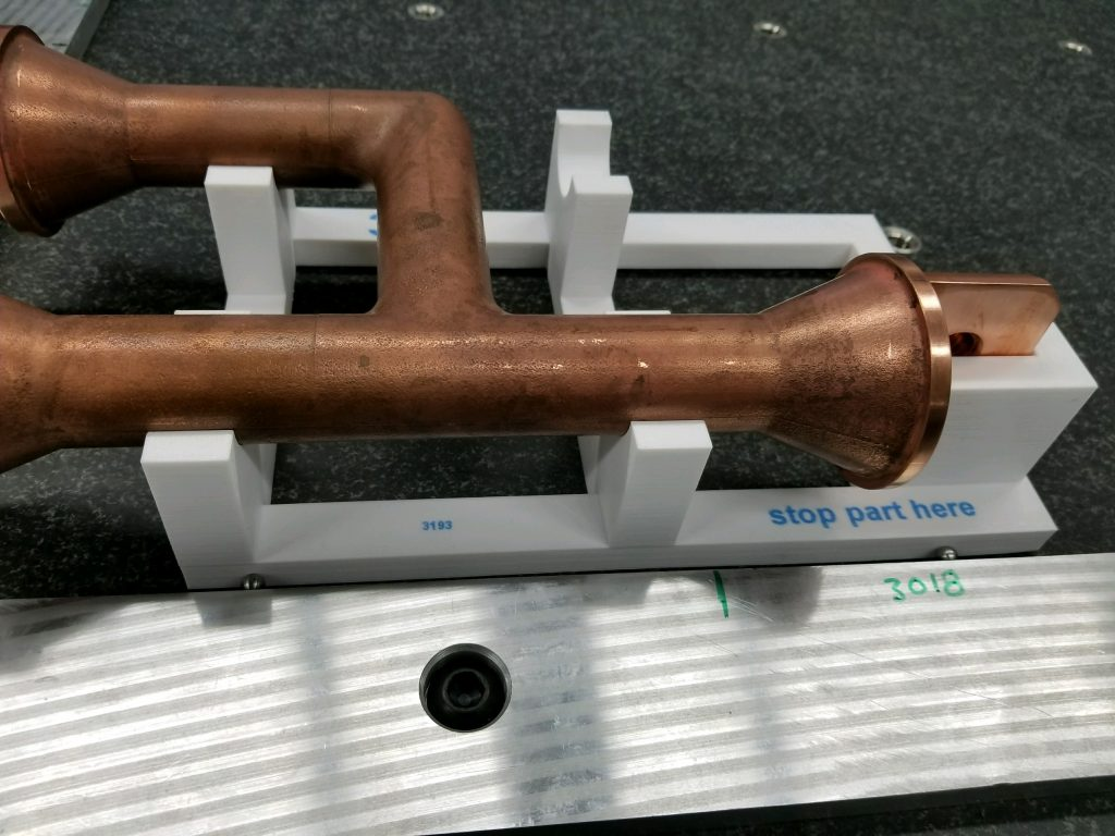 A Rize 3D printed fixture holds a copper pipe in place. Photo via HMS Industries