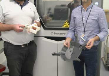 Matthieu Dumora, and Frédéric Tremoulet, Head Manager, Technical and Infrastructure Department at UPSA, holds a 3D printed camera mount. Photo via Stratasys