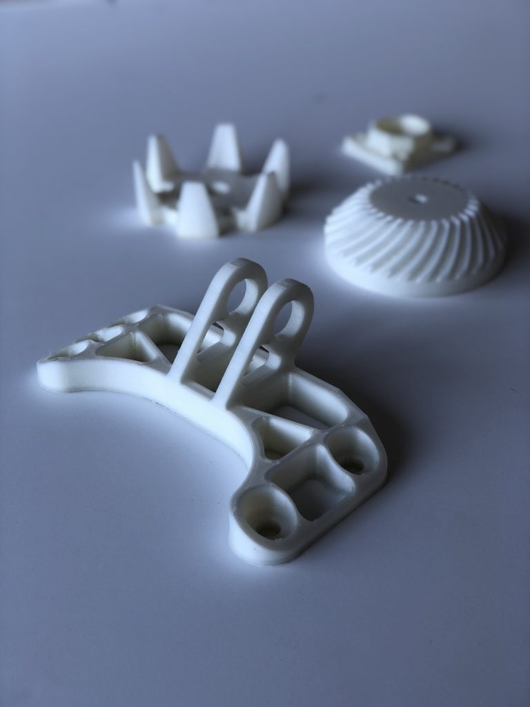 Assorted Nylon 3D printed parts in DuPont Zytel. Photo via AON3D
