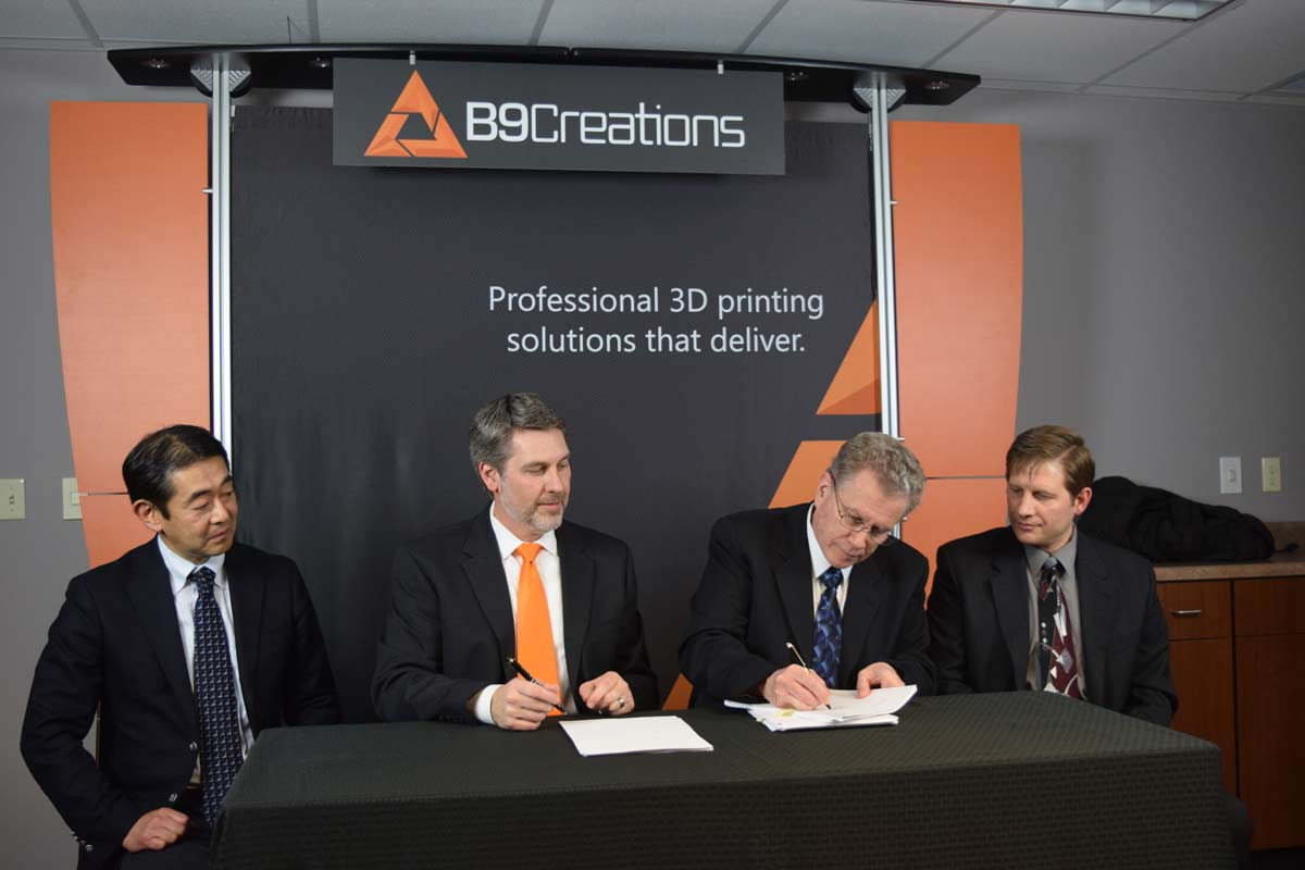 The agreement between B9Creations and Mitsui Chemicals is signed. Image via B9Creations.