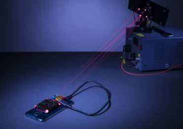 wireless phone charging system powered by lasers. Photo by Mark Stone/University of Washington