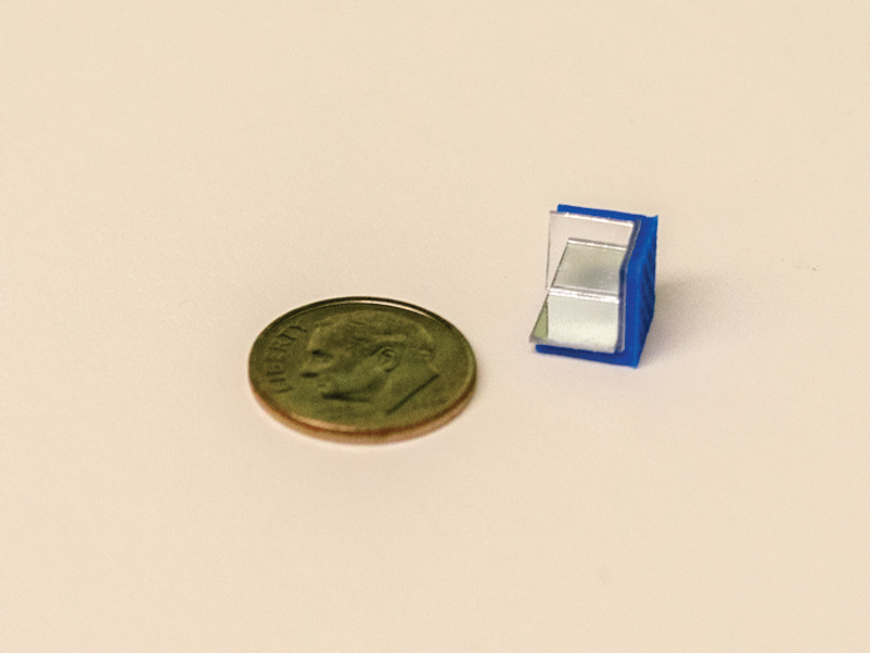 A single 3D printed retroreflector with penny cor scale. Photo via Proceedings of the ACM on Interactive, Mobile, Wearable and Ubiquitous Technologies
