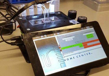 The microfluidic control instrument attached to a tablet. Photo via NYGC.
