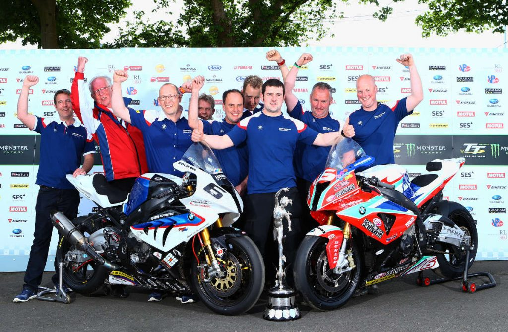 Michael Dunlop (center) and the Hawk Racing/BMW Motorrad at the 2014 Isle of Man TT. Photo via Motorcycle Daily
