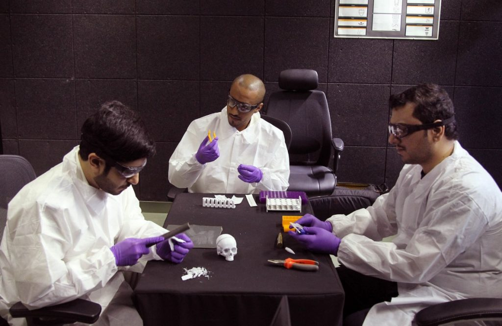 Featured image shows Abu Dhabi Police handling 3D printed models. Photo via WAM