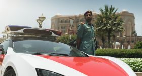 An Abu Dhabi Police officer and a Lykan Hypersport car. Photo by Simon Huber, Jonas Abenstein, Felix Berndt & Burak Ekin for Abu Dhabi Police GHQ.