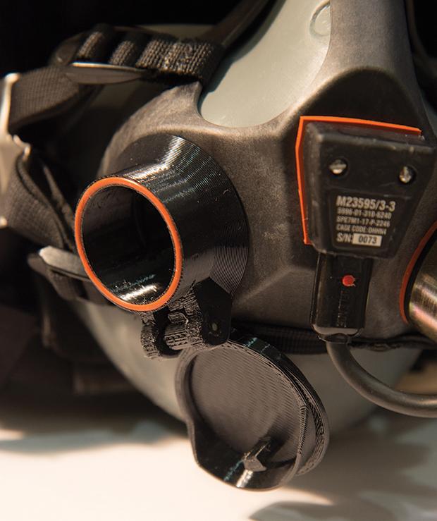 3D printed flip-top valve on the T-45 Goshawk breathing mask. Photo by Emanuel Cavallaro via NAVAIR.