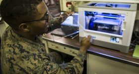 Sgt. Adrian Willis, using a 3D printer. U.S. Marine Corps photo by Cpl. Stormy Mendez