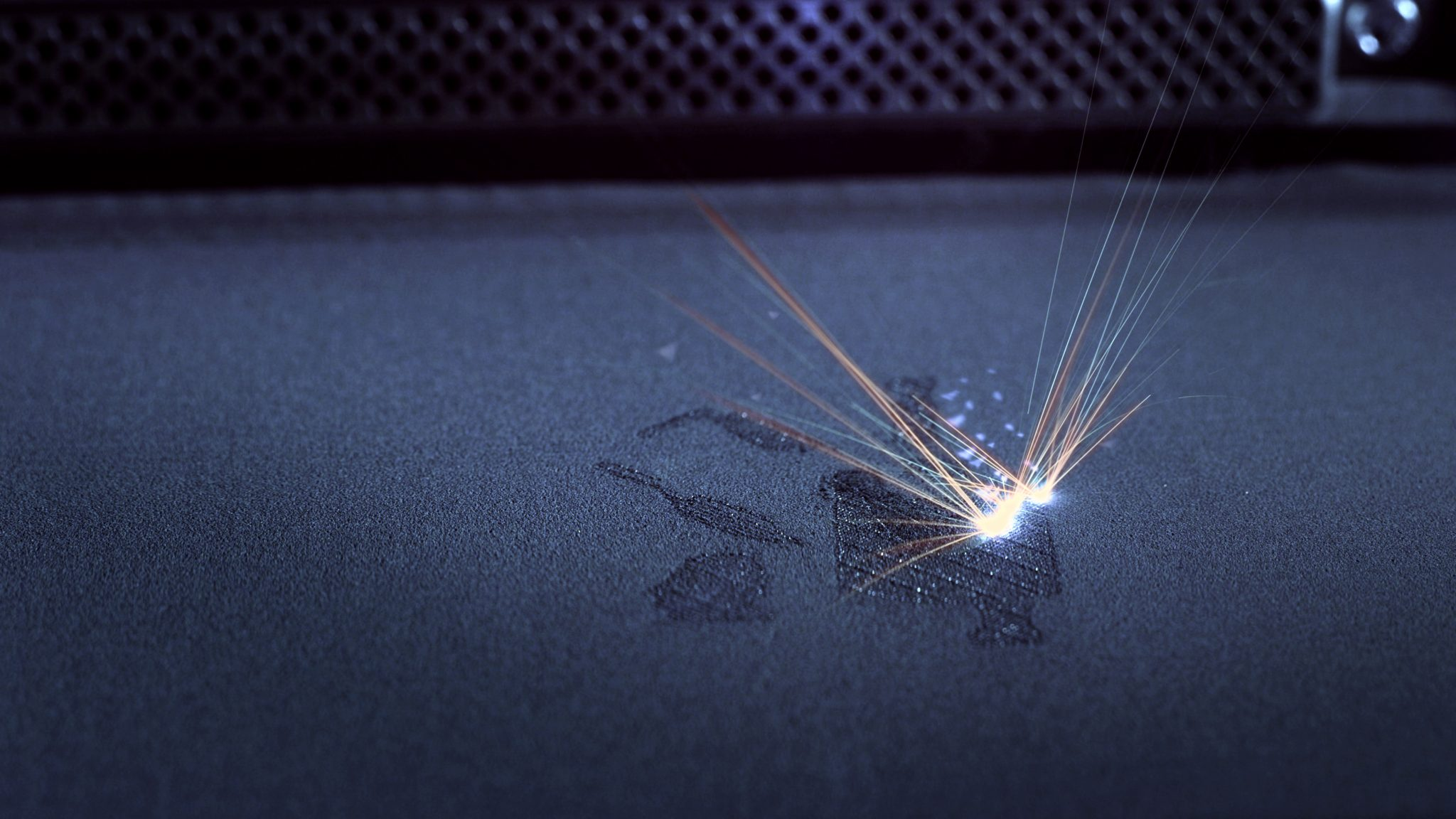 Laser powder bed fusion (LPBF) 3D printing in an EOS machine. Photo via EOS