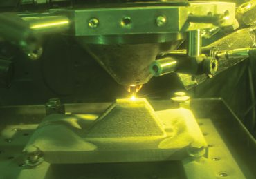 Fabricating a MV-22B nacelle link inside a directed energy deposition 3D printer. Photo via NAVAIR.