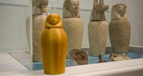A miniature, 3D printed, canopic jar in front of the real deal at Touchstones Museum. Photo via Fab Lab Warrington/Warrington Guardian