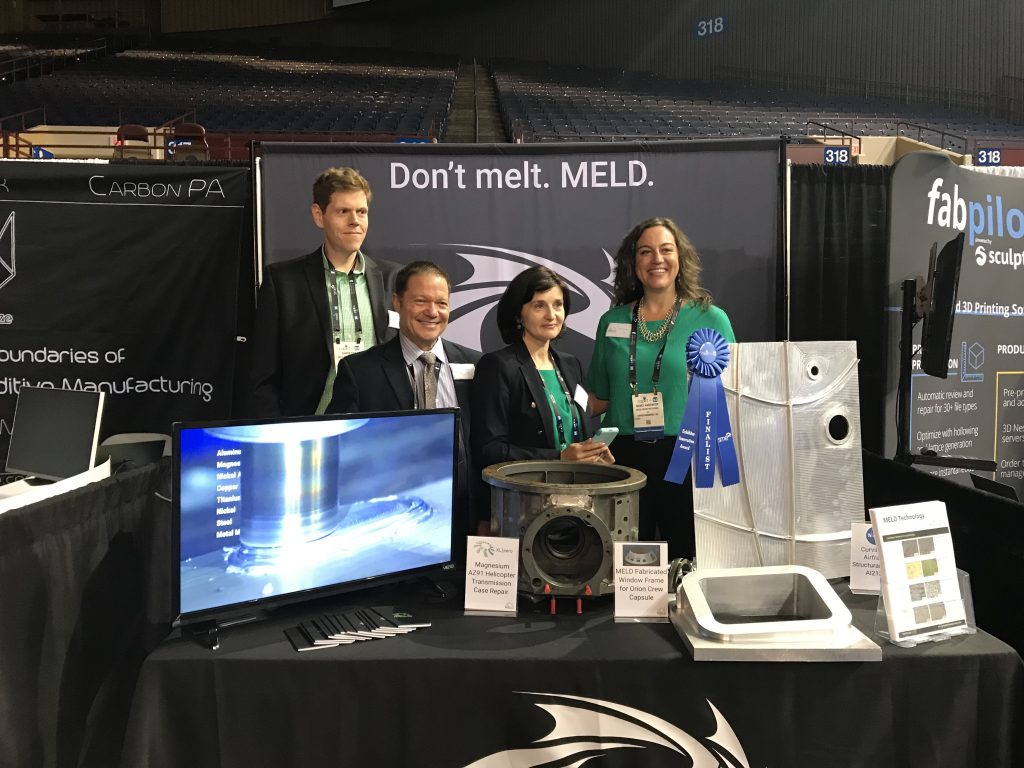 Nanci Hardwick (right) and the MELD Manufacturing team at RAPID + TCT 2018. Photo by Beau Jackson