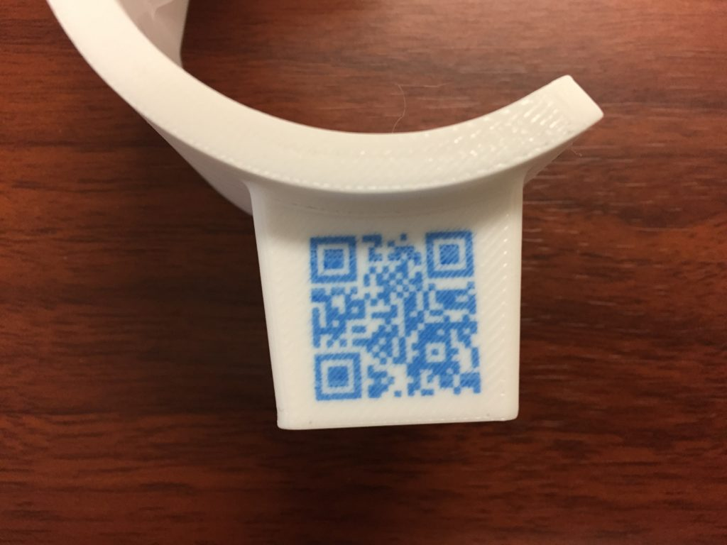 QR code embedded into a 3D printed part. Photo via Rize.