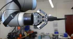 Close-up of the Robotiq gripper on a UR10 robotic arm installed at Voodoo Manufacturing in Brooklyn. Photo via Universal Robots