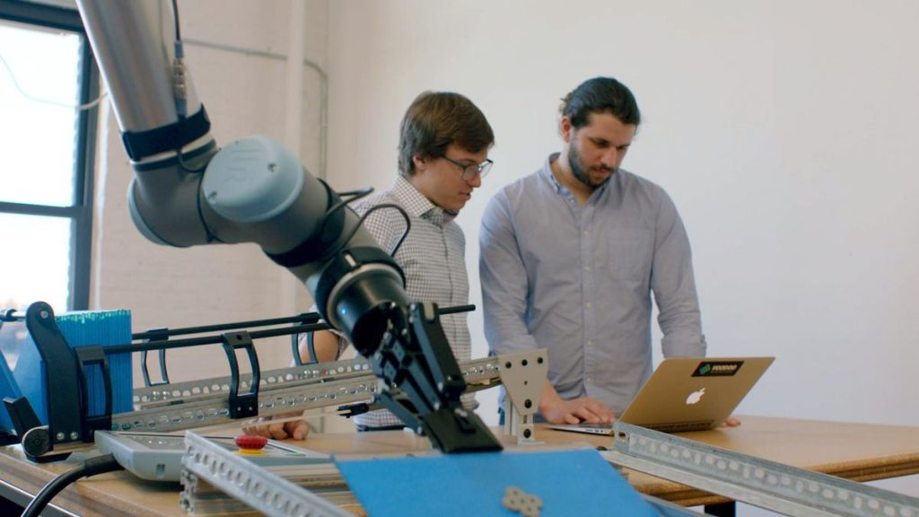 Humans and UR robots in close-collaboration. Photo via Voodoo Manufacturing/Universal Robots