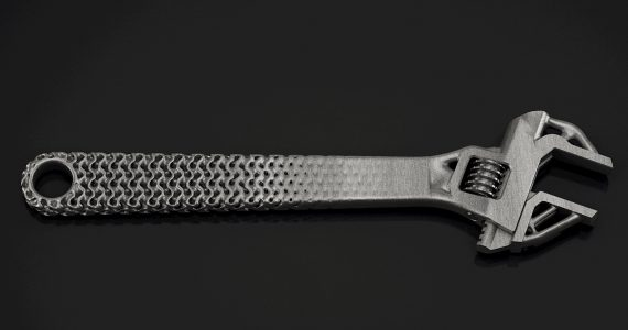 Metal 3D printed wrench demonstrating the blend between lattices and traditional CAD. Phoot via Frustum