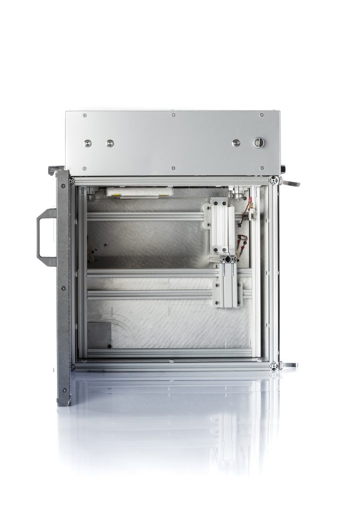 Inside the Sintratec Kit SLS 3D printer. Photo via Sintratec.