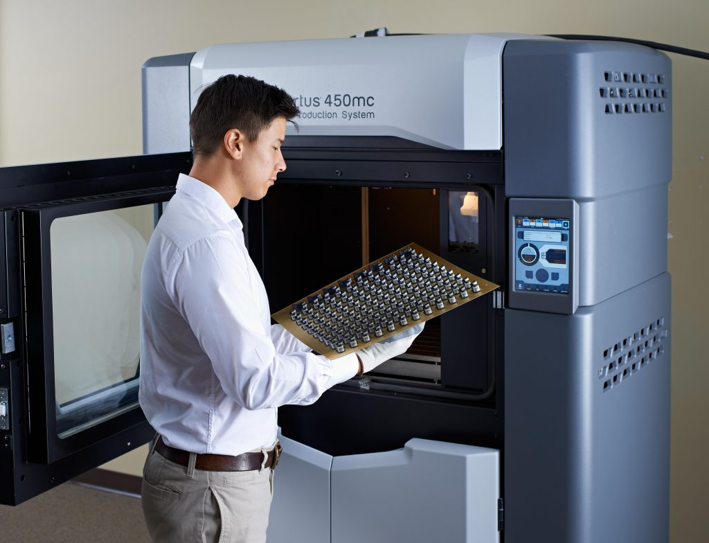 The Stratasys Fortus 450mc delivers models in nine production-grade materials that can be used in real manufacturing applications. Photo via Javelin Technologies.