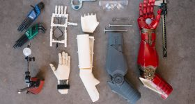 Limbitless Solutions 3D printed arms. Photo via Limbitless Solutions/Adobe