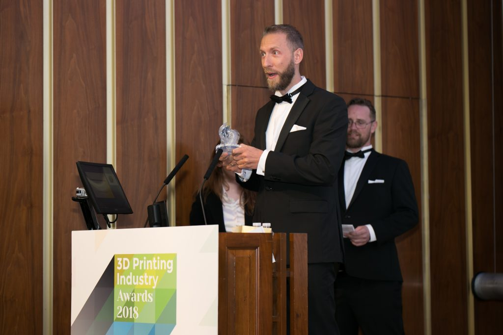 Daniel Cohn, General Manager, Protolabs Germany, 3D Printing, collecting the 2018 Creative Use of 3D Printing Industry Award.