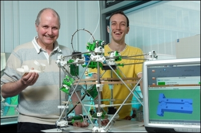Ed Sells and Dr. Adrian Bowyer with the first RepRap 3D printer. Photo via RepRap