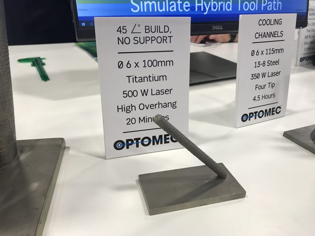 An overhanging 3D printed titanium rod 3D printed by Optomec LENS technology similar to the straight rods made at CMI. Photo by Beau Jackson