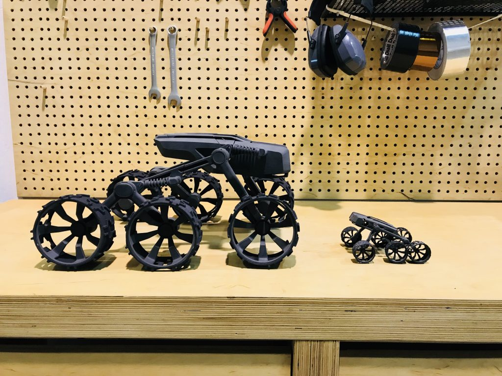 3D printing capability on the LISA 2 (left) vs the LISA 1 (right). For reference, the body, spring legs and two wheels of the vehicle on the left can be 3D printed in a single LISA 2 build. The remaining 4 wheels are 3D printed in a second. The spring legs on this vehicel could not have been 3D printed in a single piece on the LISA 1 3D printer. Photo by Beau Jackson